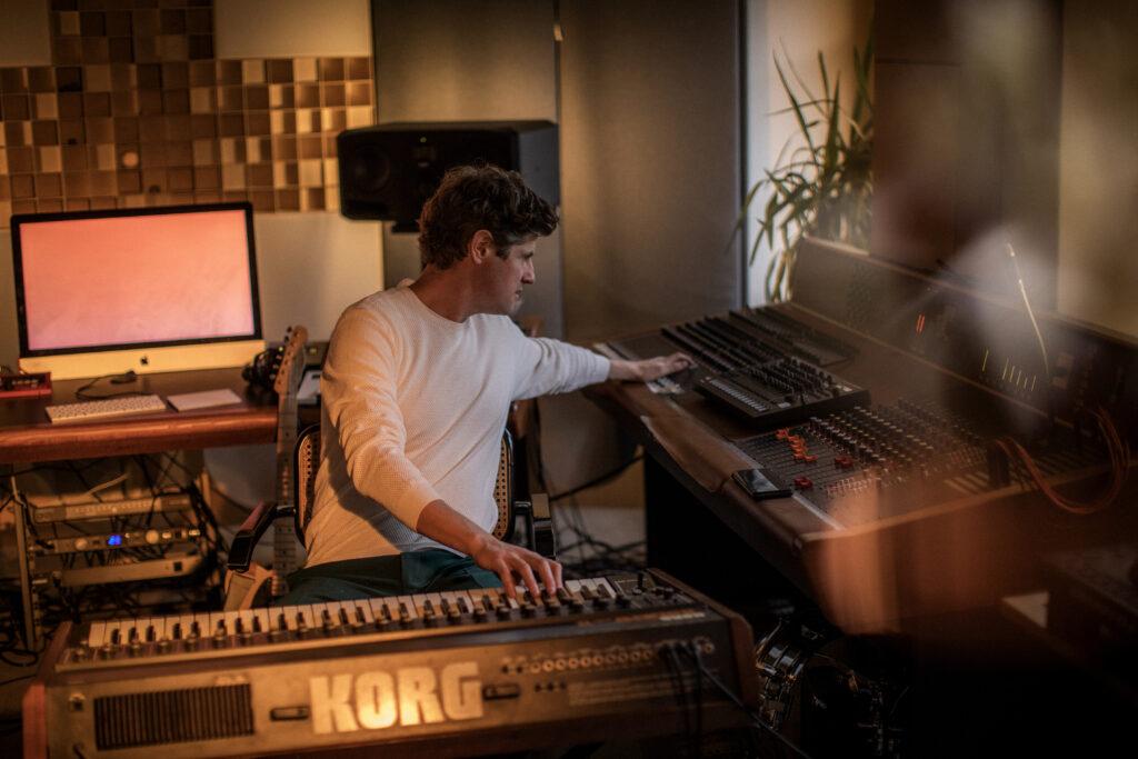 Mano Le Tough sitting in his studio